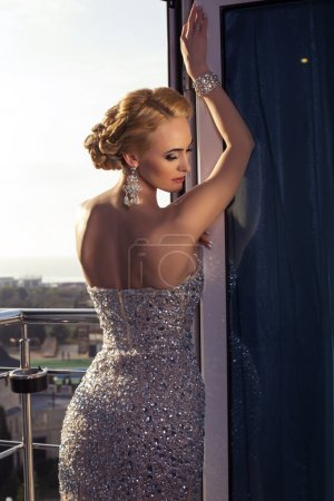 Beautiful glamour woman with blond hair in luxury dress