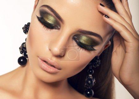 portrait of sexy beautiful brunette with smokey eyes makeup