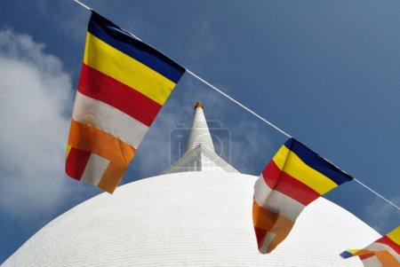 Buddhist flag Mahaseya stupa, Mihintale, Sri Lanka