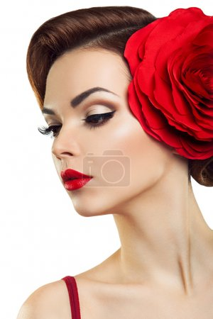 Passionate lady with a red flower in her hair.