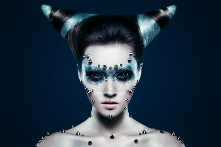 Photo for Demon girl with spikes on the face and body. Black eyes - Royalty Free Image