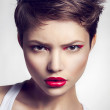 Portrait of beautiful girl with red lips and short hair