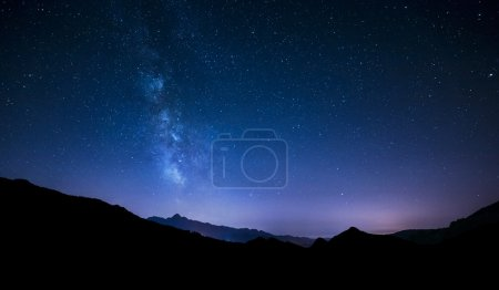 Photo for Night summer sky panorama over mountain. Moving stars and Milky way - Royalty Free Image