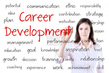 Young business woman writing career development concept. Isolated on white.