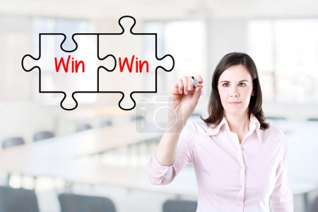 Businesswoman drawing a Win Win Puzzle Concept on the virtual screen. Office background.
