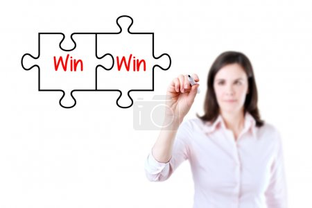 Businesswoman drawing a Win Win Puzzle Concept on the virtual screen. Isolated on white.