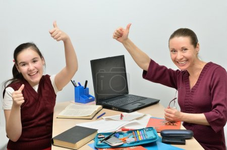 Teacher and pupil glad successful learning