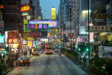 Hong Kong, China - February 23, 2014: Nathan Road is the main thoroughfare in Kowloon, Hong Kong that lined with shops and throngs with tourists, The total length of the Nathan Road is about 3.6km.