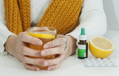 Vitamins, medicines and hot tea with lemon for a w...
