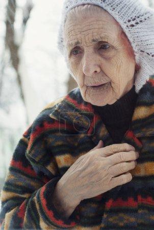Portrait of a sad old woman