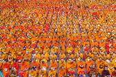 BANGKOK , THAILAND - September 8 : 10,000 Buddhist monks waiting for people give food offerings on September 8, 2013 Pratunam in Bangkok, Thailand.