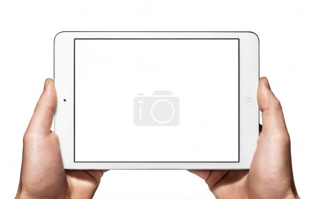 Photo for Man's hands holding an Apple new white ipad mini in horizontal mode. - Royalty Free Image