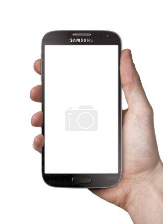 Holding Samsung Galaxy S4 black