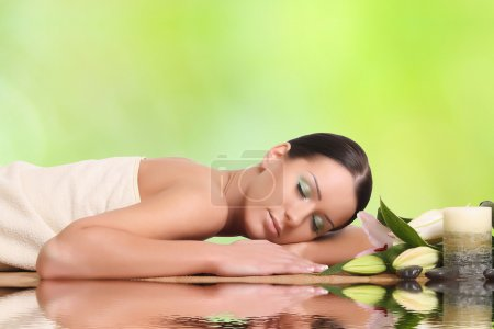 Photo for Young healthy girl relaxing in spa - Royalty Free Image