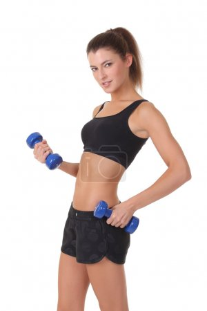 sporty girl with dumbbells.over white background