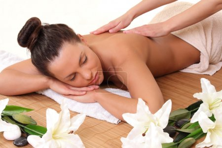 beautiful woman getting a massage in the salon