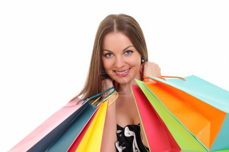 Portrait of young woman with shopping bags against white background