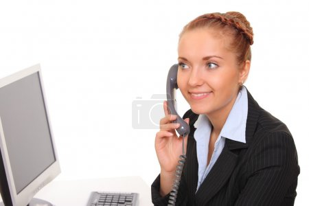young business woman speaks by phone