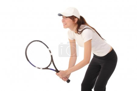 Slim brunette playing tennis