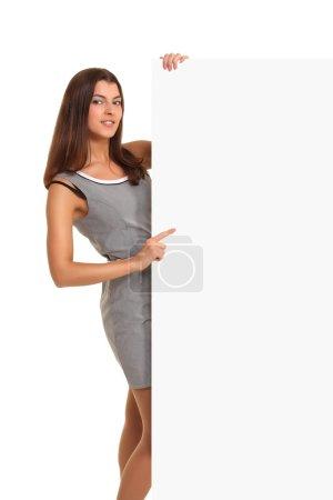 Woman pointing at billboard