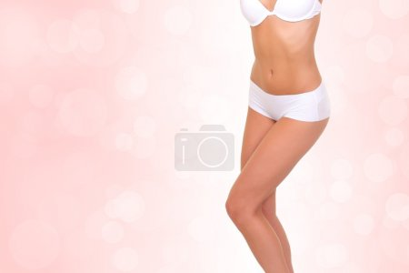 Slim female body on an abstract background