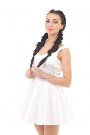 Beautiful fashionable woman in a white dress