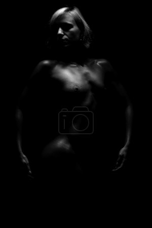 Nude woman, isolated on black background