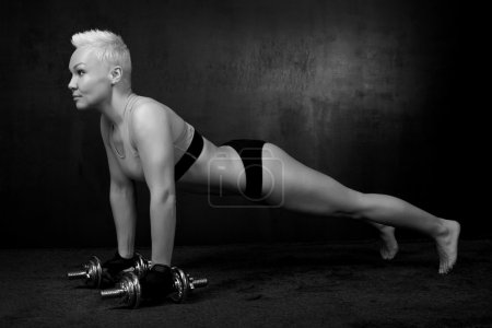 Sporty woman with a dumbbell