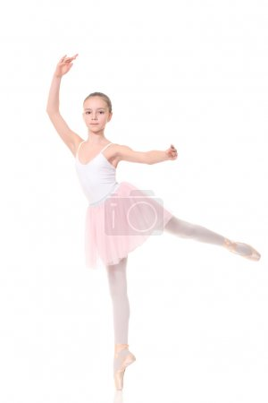 school age girl playing dress up wearing a ballet tutu