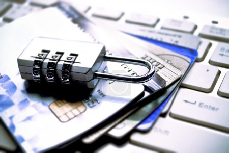 Lock and credit cards on keyboard