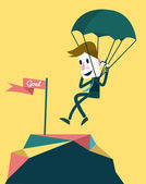 Businessman landing to the goal with parachute