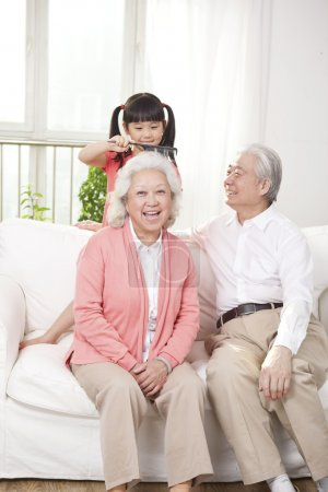 Couple with granddaughter