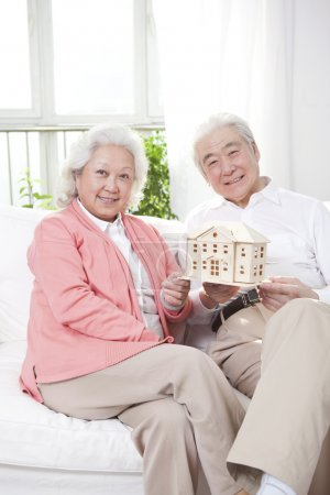 Couple holding building model