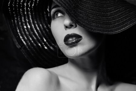 Mysterious woman in black hat