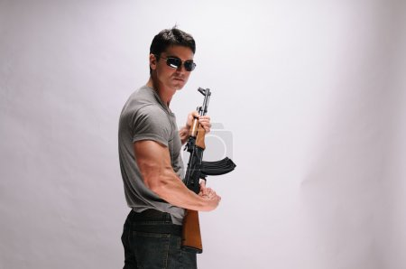 Handsome man with rifle