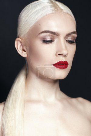 Portrait of beautiful girl wih blonde hair close up isolated on black background