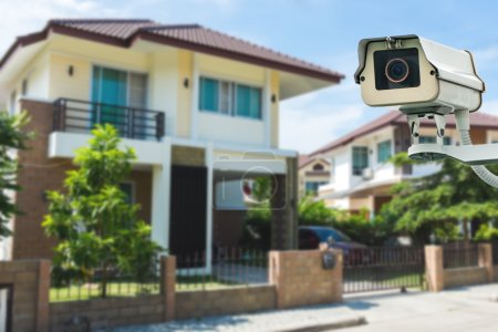 CCTV Camera with house and village in background