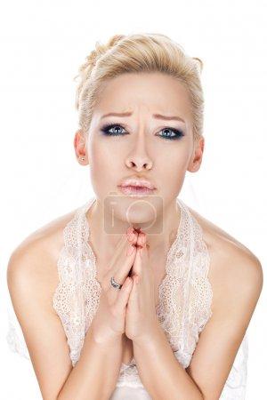 Bride praying.