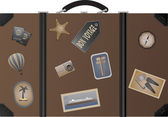 Travel suitcase with postage stamps
