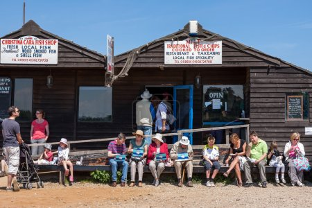 People enjoying fish and chips in Southwold Suffolk