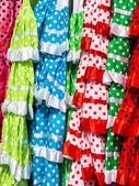 Brightly coloured girls spanish dresses