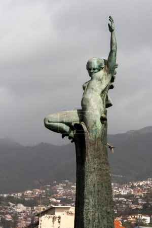 Statue of naked woman arm outstretched in Funchal
