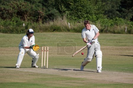 Photo for Village cricket being played at Coleman's Hatch - Royalty Free Image