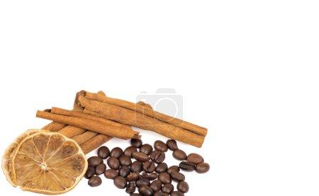 coffee beans, cinnamon and lemon