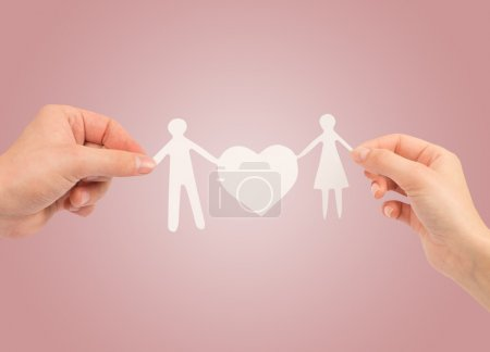 paper family in hands isolated on a white background