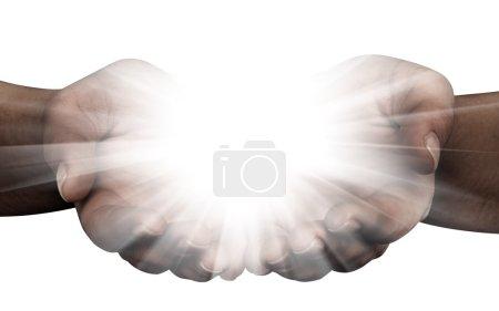 Photo pour Tenir les mains ouvertes avec des lumières éclatantes - image libre de droit