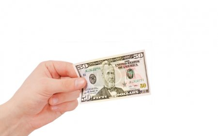 Money (Dollars) in a hand isolated on white
