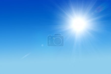 Shining sun at clear blue sky with copy space...