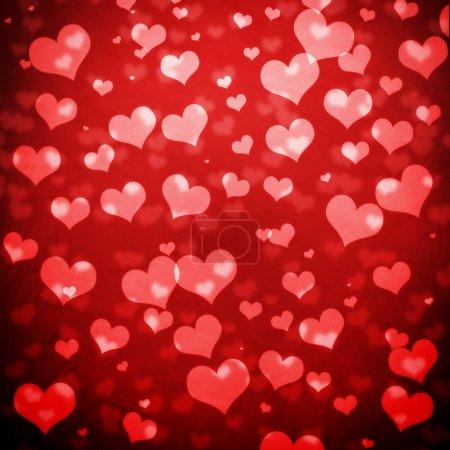 Photo pour Coeurs brillants lumière bokeh fond Saint-Valentin - image libre de droit