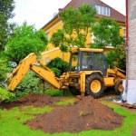 Digging excavator in the garden